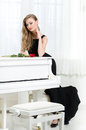 Full-length Portrait Of Woman Standing Near The Piano Royalty Free Stock Image - 34733616
