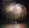 Fireworks Display Over Sea With Reflections In Water Stock Photo - 34737600