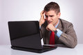 Young Business Man Looks Disappointed At Laptop Stock Photography - 34738602