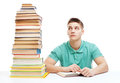 Young Frustrated Student Sitting At The Desk With High Books Sta Royalty Free Stock Photography - 34742257