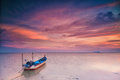 Silhouette Of A Fishing Boat At Sunset In Holiday Concept. Stock Image - 34744391