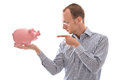 Man Pointing At His Piggy Bank Money Isolated On White Backgroun Stock Photography - 34770552