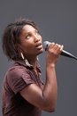 Black Woman Singing Into Microphone Stock Photo - 34770560