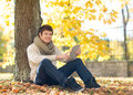 Man With Tablet Pc In Autumn Park Royalty Free Stock Images - 34771509