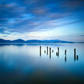 Wooden Pier Or Jetty Remains On A Blue Lake Sunset And Sky Reflection On Water. Versilia Tuscany, Italy Royalty Free Stock Photography - 34791377
