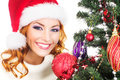 Portrait Of A Woman Decorating A Christmas Tree Royalty Free Stock Images - 34793109