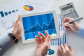 Businesspeople Analyzing Graph With Digital Tablet Royalty Free Stock Photography - 34802977