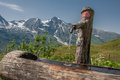 Water Tap In A Wooden Stump In Grossglockner Austria Royalty Free Stock Images - 34812119