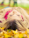 Young Woman Laying Down In Autumn Park Stock Photos - 34850723
