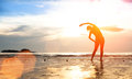 Silhouette Young Woman, Exercise On The Beach At Sunset Royalty Free Stock Photography - 34855897