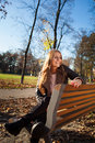 Young Woman Sitting On A Bench In The City Park In Autumn/winter Royalty Free Stock Image - 34859266