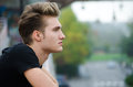 Profile  Shot Of Attractive Blond Young Man In City Royalty Free Stock Photos - 34872808