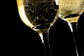 A Pair Of Flutes Of Champagne Tilted With Golden Bubbles Royalty Free Stock Photography - 34885607