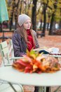 Girl Reading A Book In An Outdoor Cafe Stock Image - 34889941