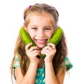 Little Girl With Cucumbers Stock Photos - 34895323