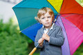 Little Cute Toddler Boy With Colorful Umbrella And Boots, Outdoo Stock Images - 34944244