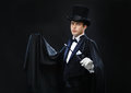Magician In Top Hat With Magic Wand Showing Trick Stock Image - 34953671