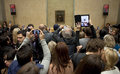 Visitors At The Louvre Looking At The Mona Lisa Royalty Free Stock Photos - 34958538