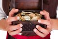 Pirate Holding Treasure Box Royalty Free Stock Images - 34960339
