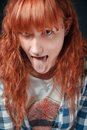 Red-haired Girl Shows Tongue Stock Image - 34987741