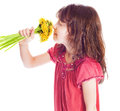 Little Girl Smelling A Flower Stock Photography - 35000272