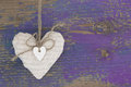 Hanging Heart And Purple Wooden Background In Country Style. Royalty Free Stock Image - 35002756