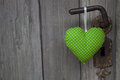 Green Heart Shape Hanging On Door Handle - Wooden Background Wit Royalty Free Stock Photography - 35003247