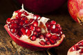 Organic Ripe Red Pomegranates Royalty Free Stock Photos - 35026908