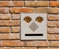 A Modern Intercom Doorbell  Panel On Old Brick Wal Royalty Free Stock Photos - 35028128