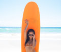 Surfer Girl Posing With Her Surfboard On The Beach Royalty Free Stock Image - 35028796