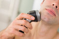 Extreme Close Up Of Man Shaving With Electric Razor Royalty Free Stock Photo - 35032865