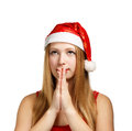 Young Woman In Santa Hat Makes A Wish Stock Photo - 35036950