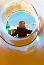 Sunny Day At The Other Side Of The Tube Slide Royalty Free Stock Photography - 35043217