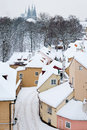 Quiet Street With Small Houses In Snow Covered Prague Royalty Free Stock Photo - 35094875