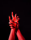 Red Demonic Hands With Black Nails, Real Body-art Stock Photo - 35102880