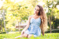 Beautiful Young Woman Sitting At Green Grass Royalty Free Stock Photography - 35105257