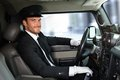 Handsome Chauffeur Driving Limousine Smiling Royalty Free Stock Photo - 35113895