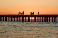 People On The Old Sea Pier During Sunset Royalty Free Stock Photo - 35113985