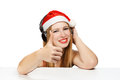 Young Woman In Santa Claus Hat And Headphones With Thumbs Up Ges Royalty Free Stock Photography - 35126987