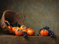 Still Life With Persimmons And Grapes Royalty Free Stock Image - 35142546