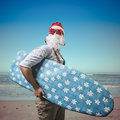 Funny Santa Claus Surfer Beach Royalty Free Stock Photography - 35150757