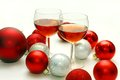 Two Wine Glasses Surrounded By Christmas Decorations Royalty Free Stock Images - 35161109