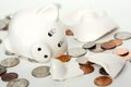 Broken Small Piggy Bank Surrounded By Spilled Coin Royalty Free Stock Photography - 35161307