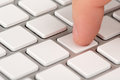 Close-up Index Finger Is Pressing A Computer Keyboard Key Royalty Free Stock Photos - 35170628