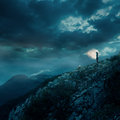 Lonely Young Woman On Top Of A Cliff At Night Stock Photo - 35179030