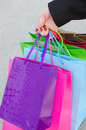 Hand Of Young Woman With Gift Bags Stock Image - 35186701