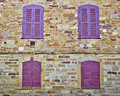 Four Red Windows On Stone Wall Stock Photography - 35194382