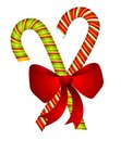 Candy Canes And Bow Isolated Stock Image - 3528801