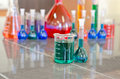 Green Beaker And Flask Royalty Free Stock Photos - 35200048