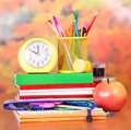 Clock And Stand For Pencils On Stack Of Books Royalty Free Stock Images - 35205429